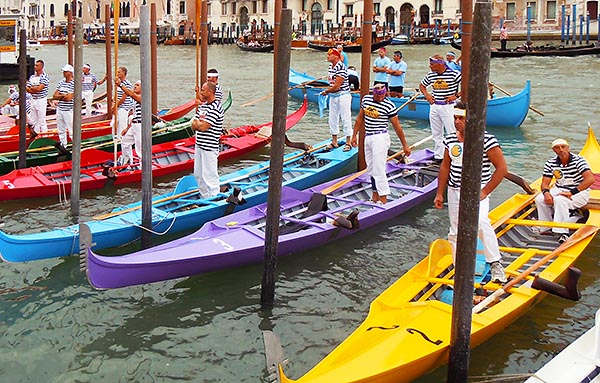 The Thursday before the Regata Storica, gondolieri wait to receive their blessing at the Salute basilica.